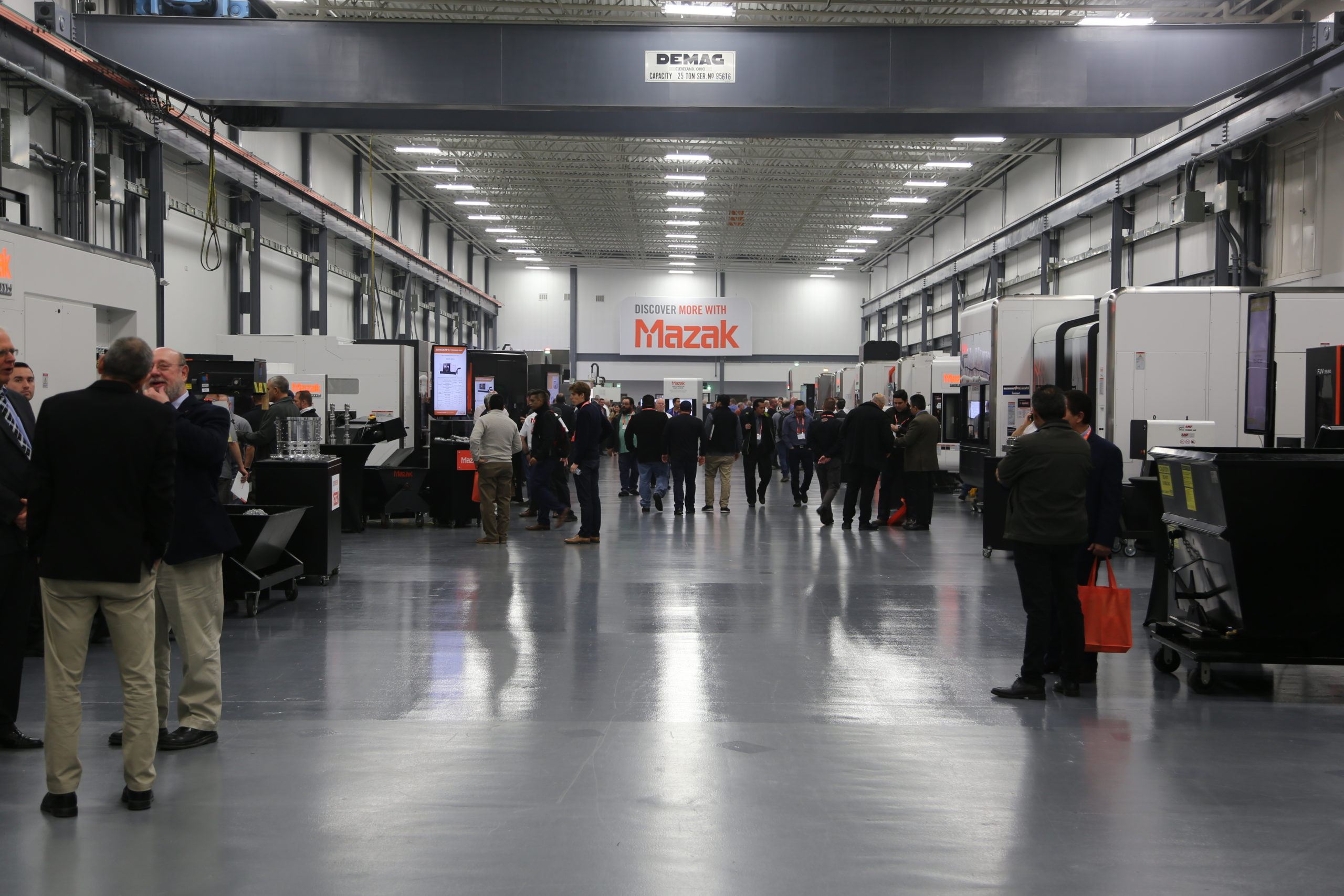 Guest Attendees discuss new machinery and technology at Mazak's DISCOVER 2019 event