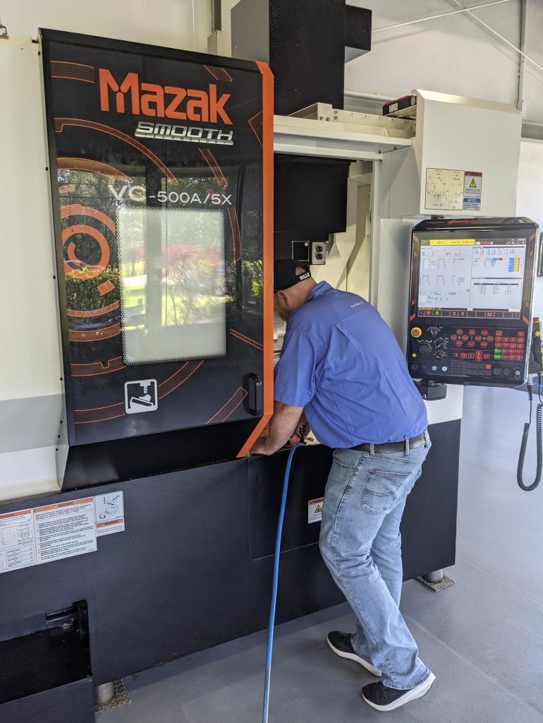 Application Engineer working on a Mazak CNC machine